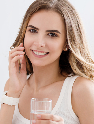 Young Woman On Phone With Glass Of Water
